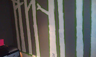 first coat of white paint on gray wall for diy wall tree painting
