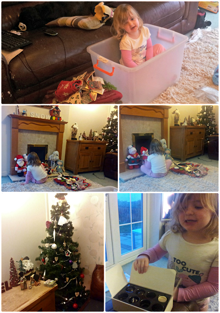 Toddler helping with Christmas decorations