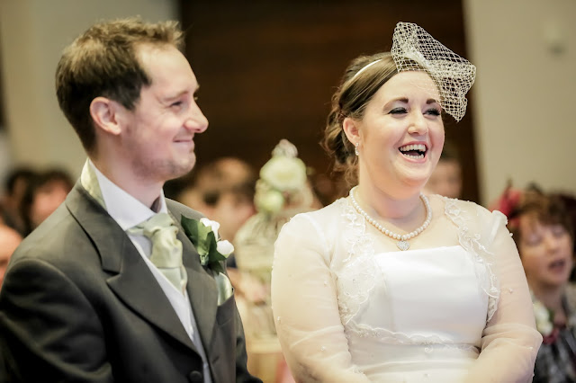 bride & groom laughing bride wears pearl necklace and birdcage veil