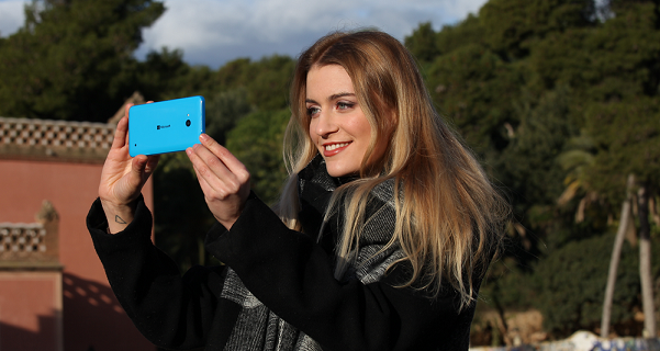 A girl holding a Lumia 640