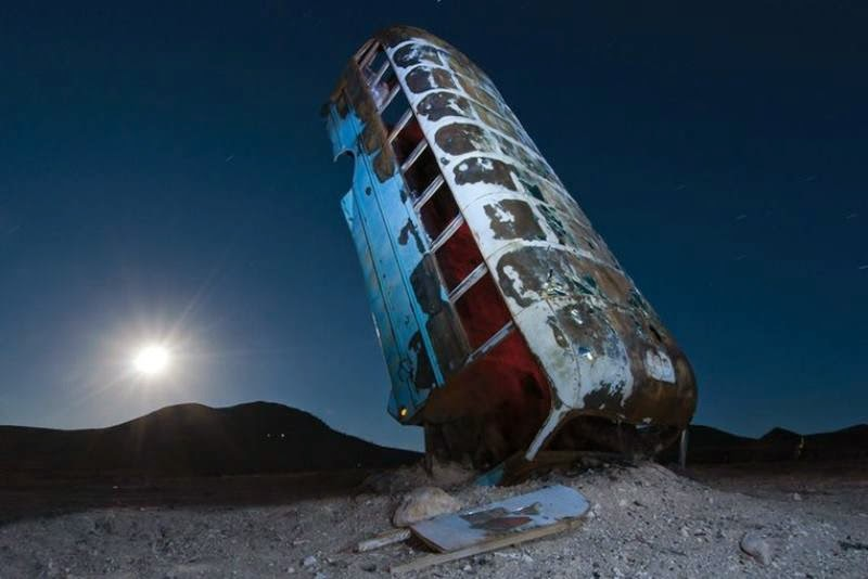 At the edge of Goldfield, a small town in the middle of Nevada, multiple cars, buses, vans, and limos are buried vertically in the desert as if they are growing out of the ground.