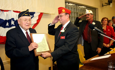 Commander salutes Elmer Moje