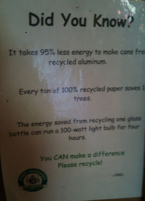Sign says: Did You Know? It takes 95% less energy to make cans from recycled aluminum.  Every ton of 100% recycled paper saves trees.  The energy saved from recycling one plastic bottle can run a 100-watt light bulb for four hours.  You CAN make a difference.  Please recycle!