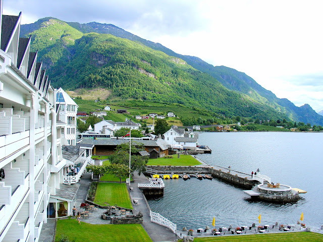The magnificent exterior view of hotel is surrounded by sublime vistas of the Sørfjord and the mountains that cradle this branch of the Queen's Fjord aka Hardangerfjord. Photo: EuroTravelogue™.