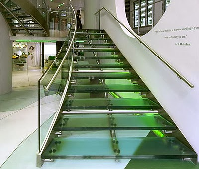 metal stairs with glass steps and metal handrails
