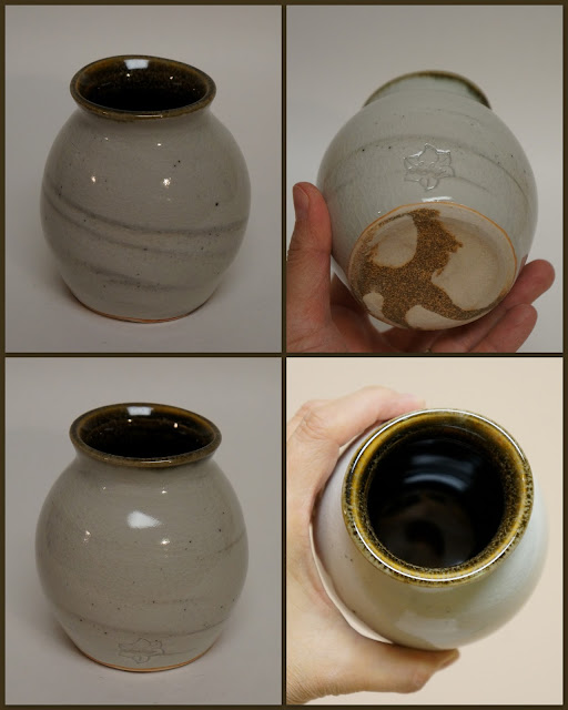 Ceramic pottery vase / vessel with marbled design.
