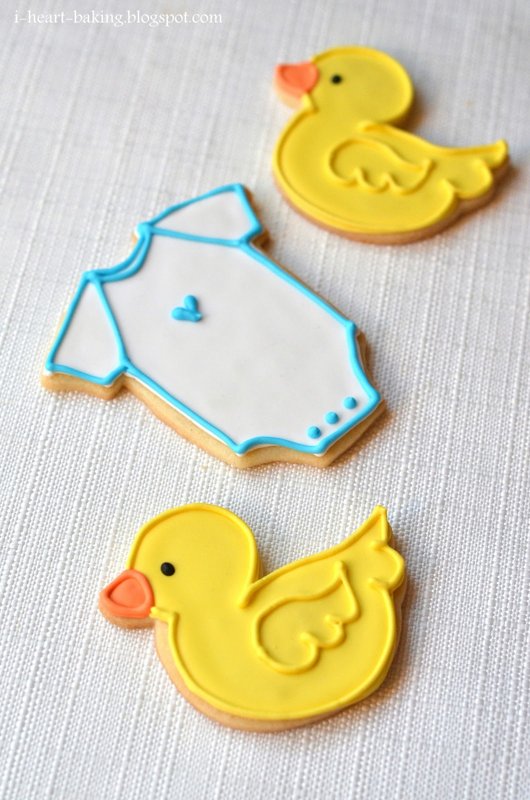 heart baking baby shower duckie and onesie cookies