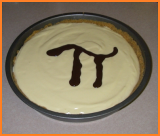 Cheesecake with the Pi symbol made with chocolate syrup on top.