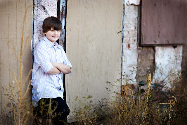 Tucson Child poses with his arms crossed during photo shoot