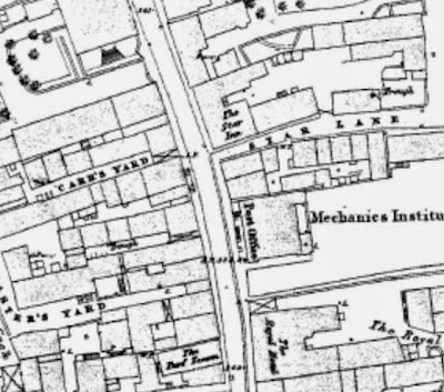 Map snip showing narrow plots either side of a main north south street.  To the centre right is Star Lane and just above the large Star Inn