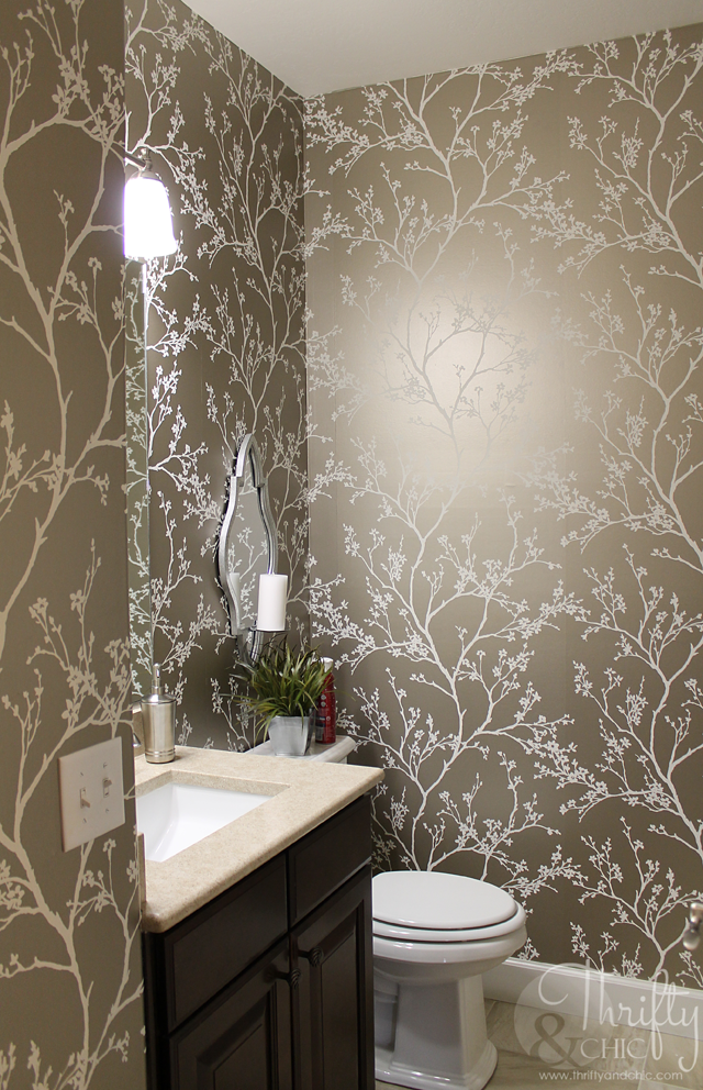 pretty half bath with wallpaper