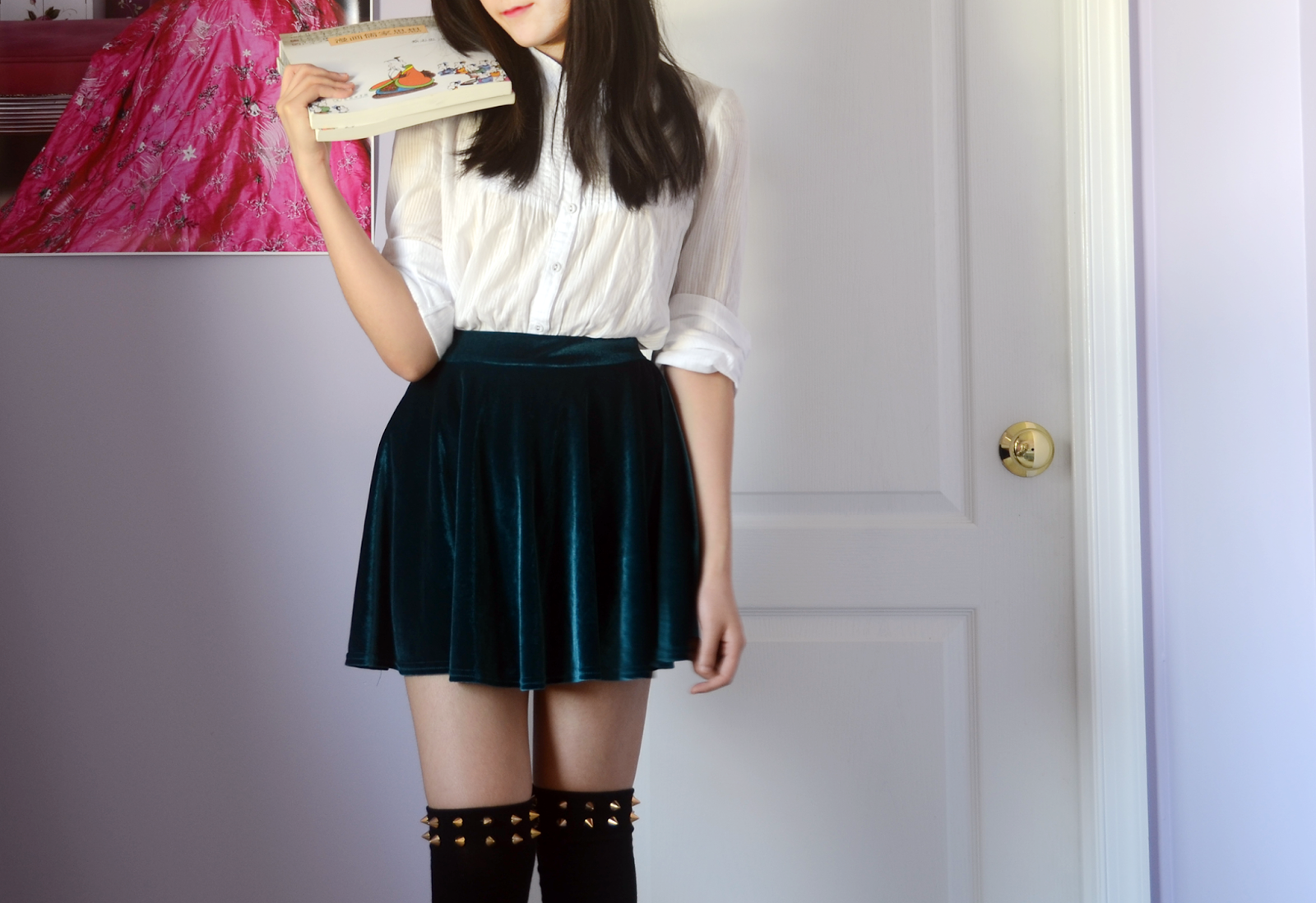 Grungy, preppy twist on a school uniform with spiked knee socks and velvet