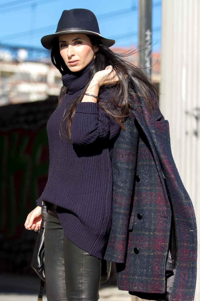 Navy turtleneck and plaid coat by Zara