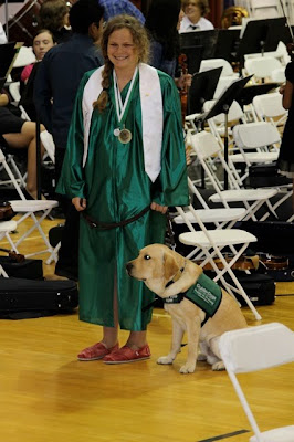 Sophie Mesches and yellow Lab Luigi
