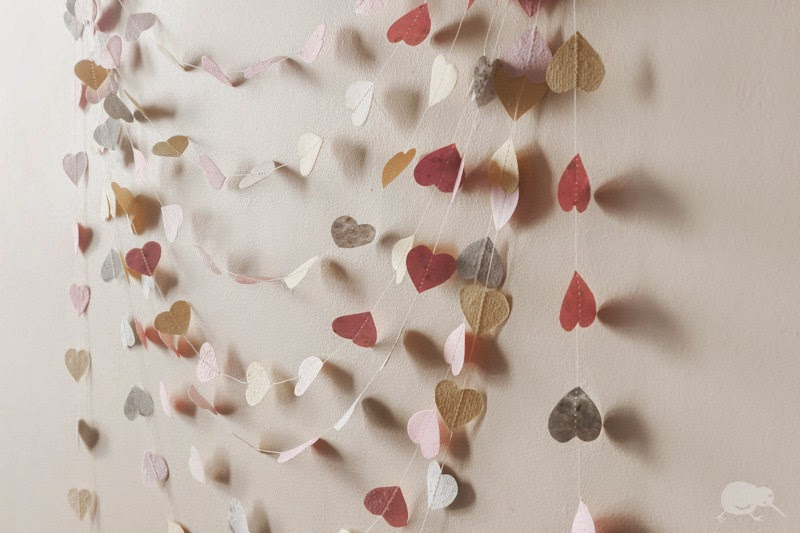 http://www.onewed.com/photos/show/recycled-wedding-decor-paper-heart-garland