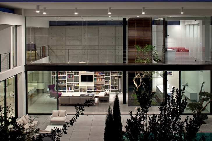 Glass wall at night in Modern Bauhaus Mansion In Israel