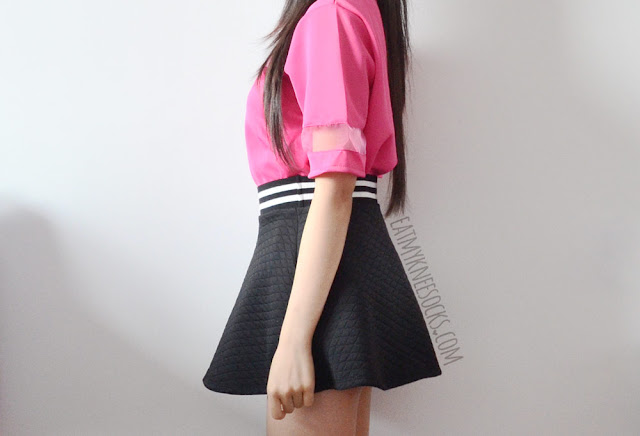 A casual ulzzang-inspired outfit, featuring CrossWalk's Korean fashion-style boxy hot pink mesh-paneled T-shirt and a striped black skater skirt.