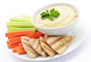 Hummus with pita chips and vegetables