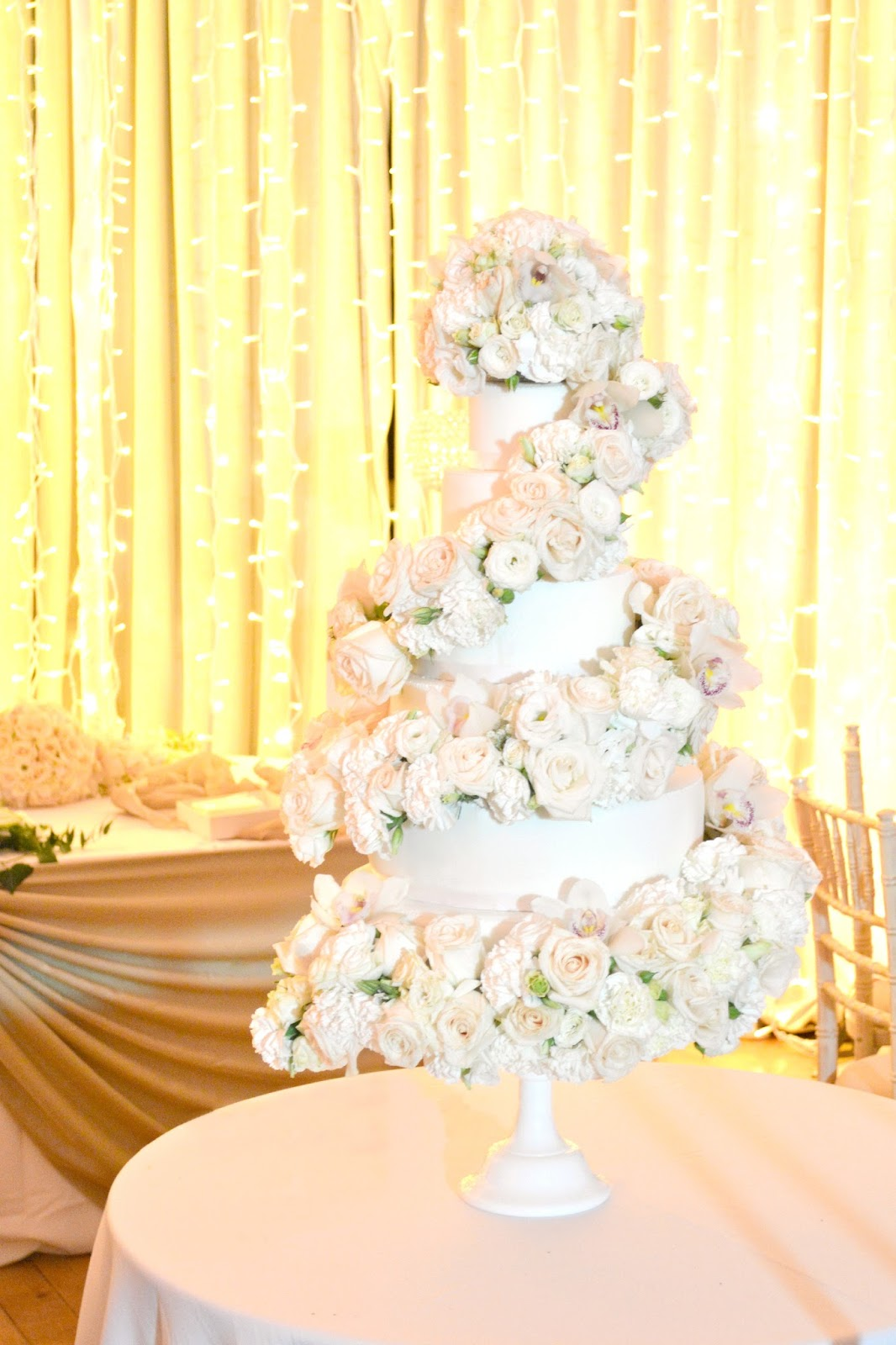 6-tier Ivory Rose and Orchids Cascade Wedding Cake | Chérie Kelly