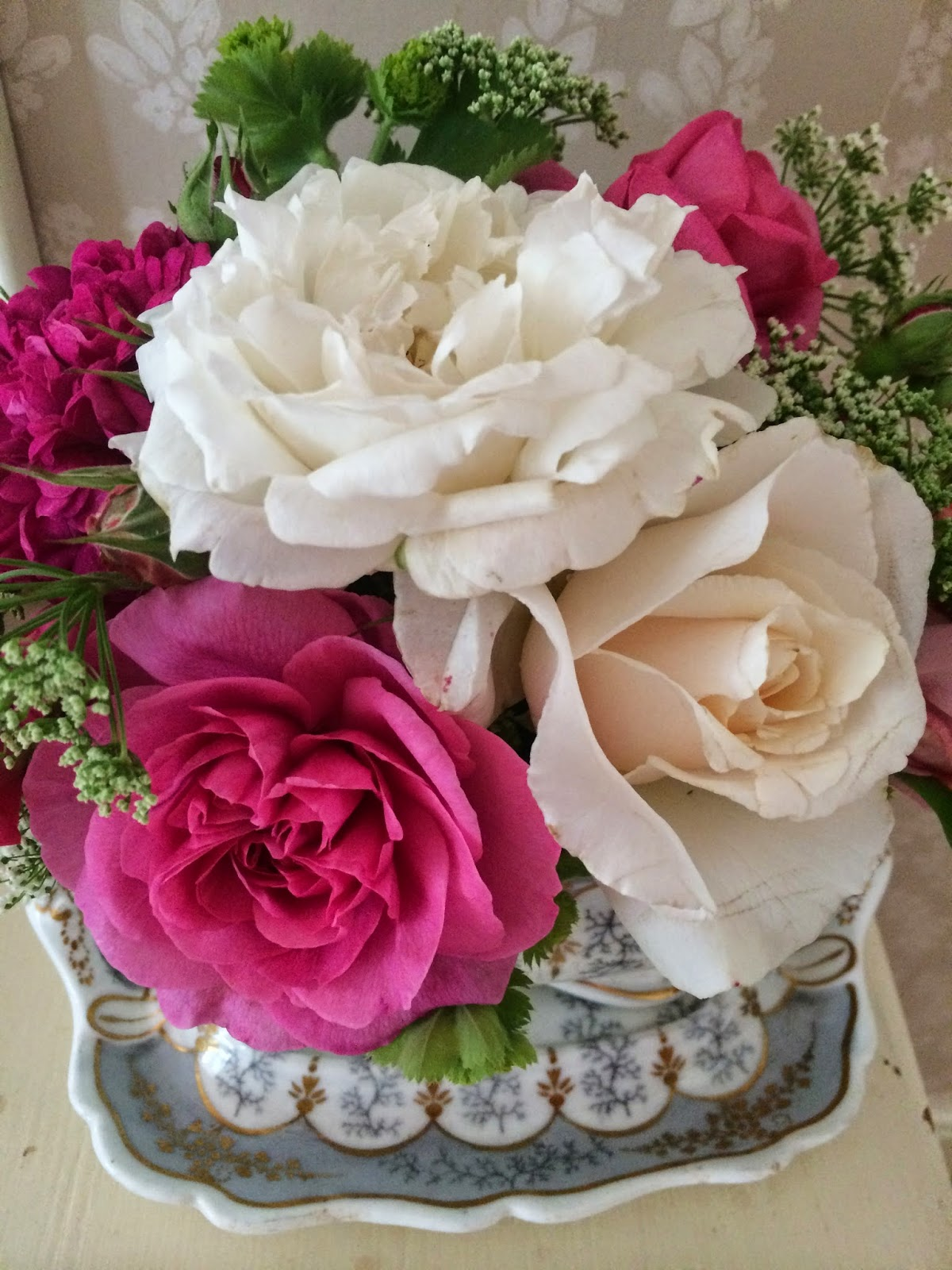 Perfumed garden roses in an ornate vintage sauce tureen.