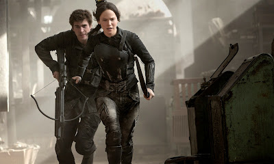 Liam Hemsworth and Jennifer Lawrence in The Hunger Games Mockingjay Part 1