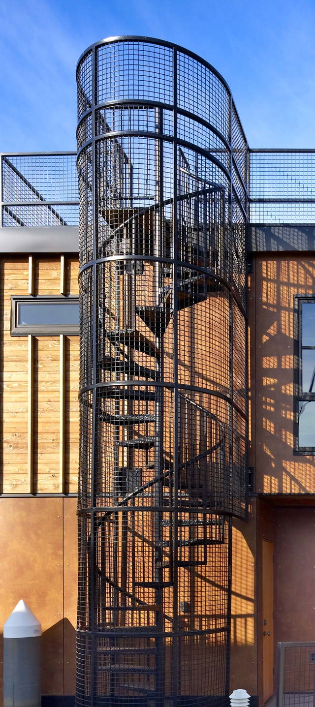 Photo of exterior spiral stairs on the floating home