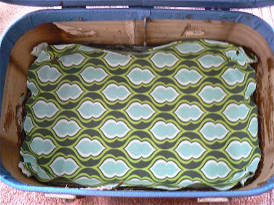 upcycled train case fabric inside