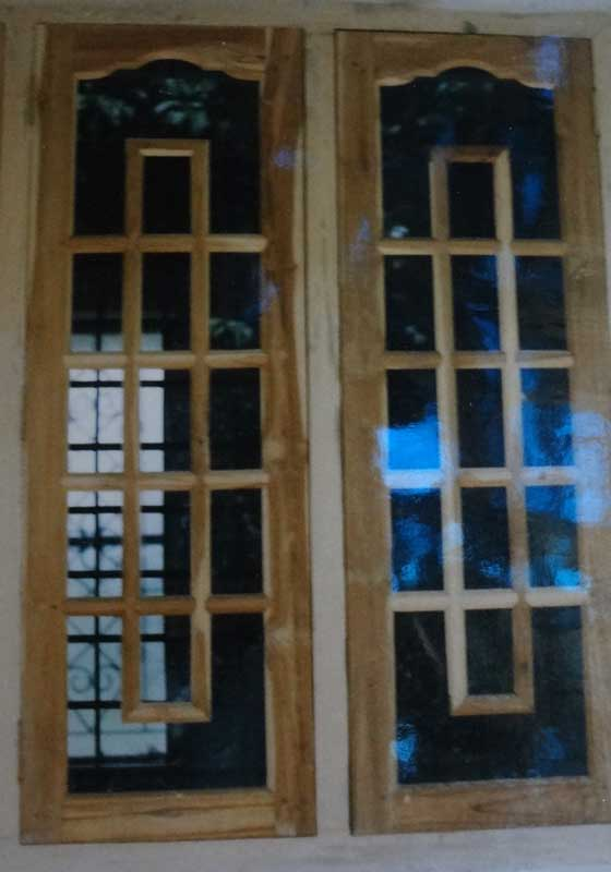 Latest kerala model wooden window door designs wood for Window door design