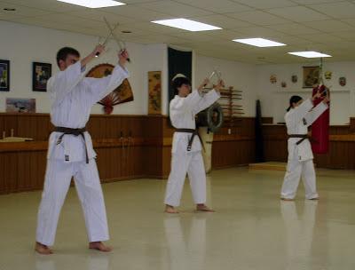 Nicholas Demoskoff Isshin Ruy karate student with Sai