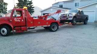 wrecker-with-wheel-lift-towing-a-ford-truck