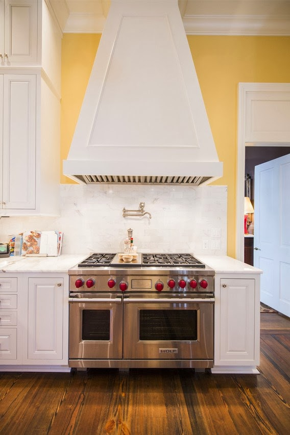 Bright kitchen with yellow walls and marble backsplash