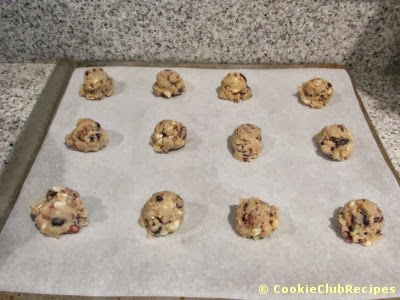 cookie dough with parchment on baking sheet