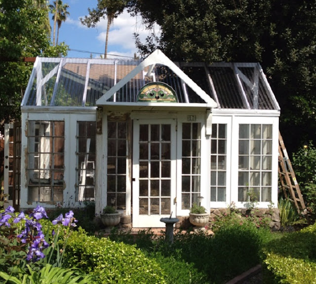 The art of up cycling diy greenhouses build a green for Reclaimed window greenhouse