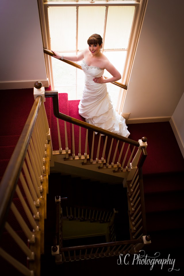 Bride staircase Alma Michigan college chapel wedding photographer
