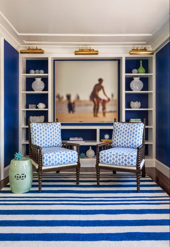 navy blue and white living room with spindle chair and striped rug