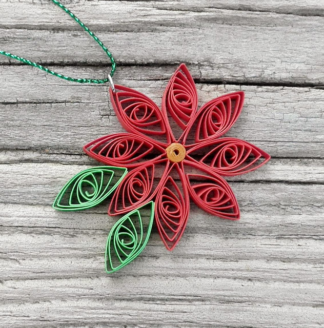 http://ladylack.storenvy.com/collections/431029-a-quilled-christmas/products/3754777-bright-poinsettia-ornament