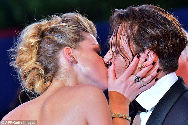 Amber Heard and Johnny Depp share intense kisses at 'The Danish Girl' Venice premiere