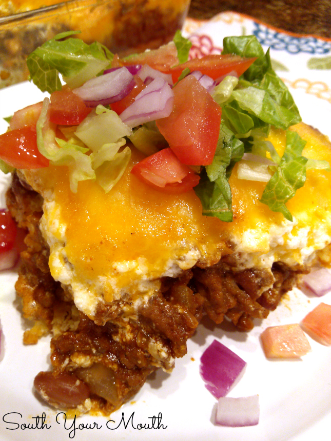 "Chili Cornbread Pie! This casserole has a cornbread ""crust"" with chili and a creamy cheese topping. Top it off with with fresh lettuce, onions and tomatoes."