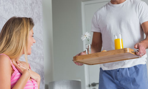 5 Crazy Ways to Surprise Her,breakfast in bed man bring food to a woman juice