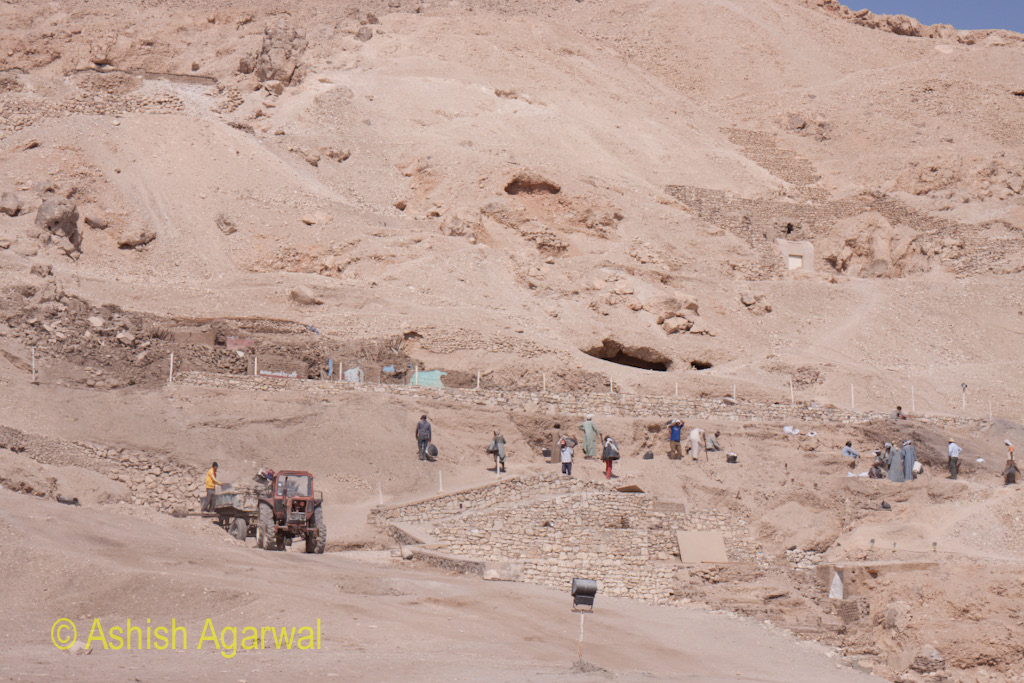 A number of Egyptian workers at a site near the Valley of Kings, working on further excavations