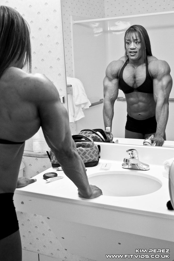 Kim Perez Flexing Her Massive Chest And Triceps