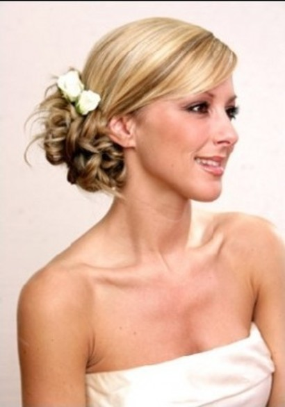 Pretty and sexy Up do Wedding Hairstyle with side up do style and flower