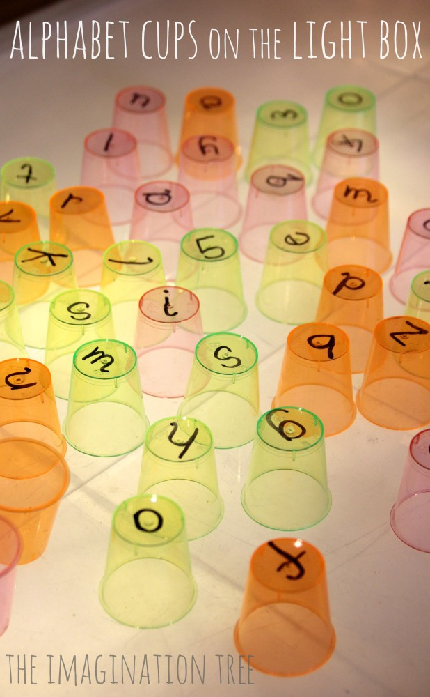 Alphabet cups on the light table from The Imagination Tree