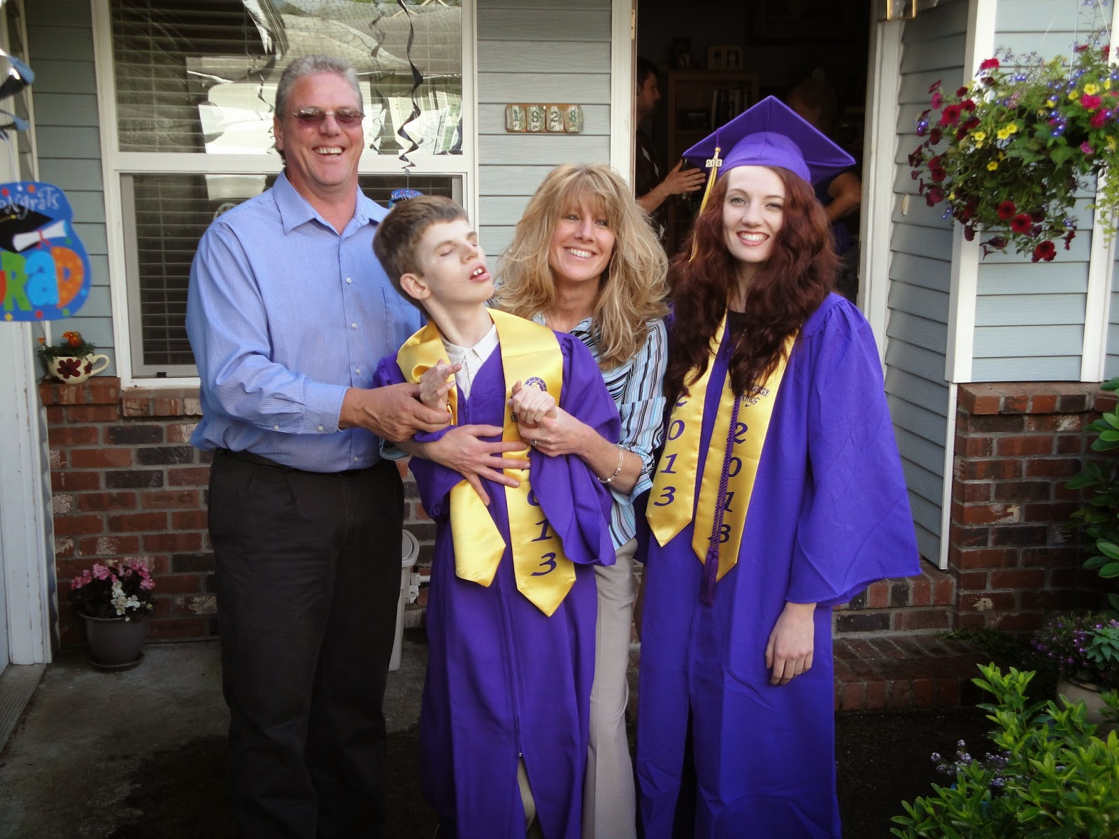 Gregory and family after graduation