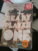 Ready Player One by Ernest Cline on a desk.