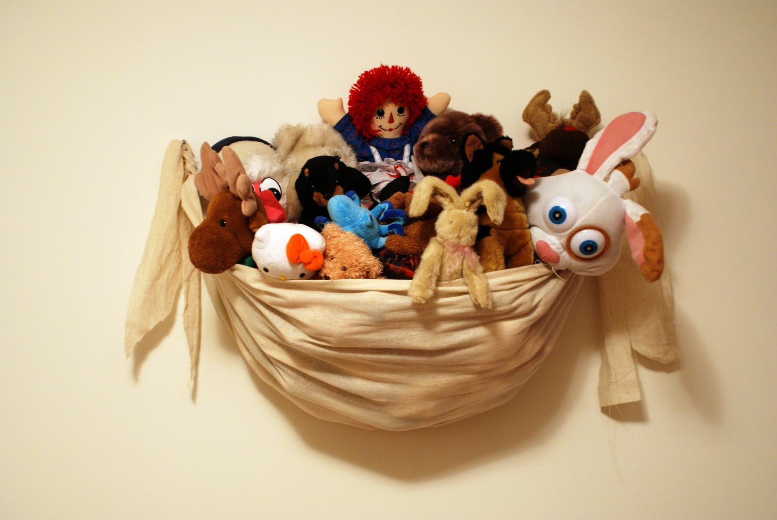 I was inspired to make this hammock for stuffed animals by those nets they sell for in the corner of a room. I just didnu0027t want to buy one of those and ... & The Better Nester: Wall Hanging Stuffed Animal Storage Tutorial