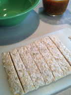 Cutting the tempeh for Citrus and Maple Glazed Tempeh