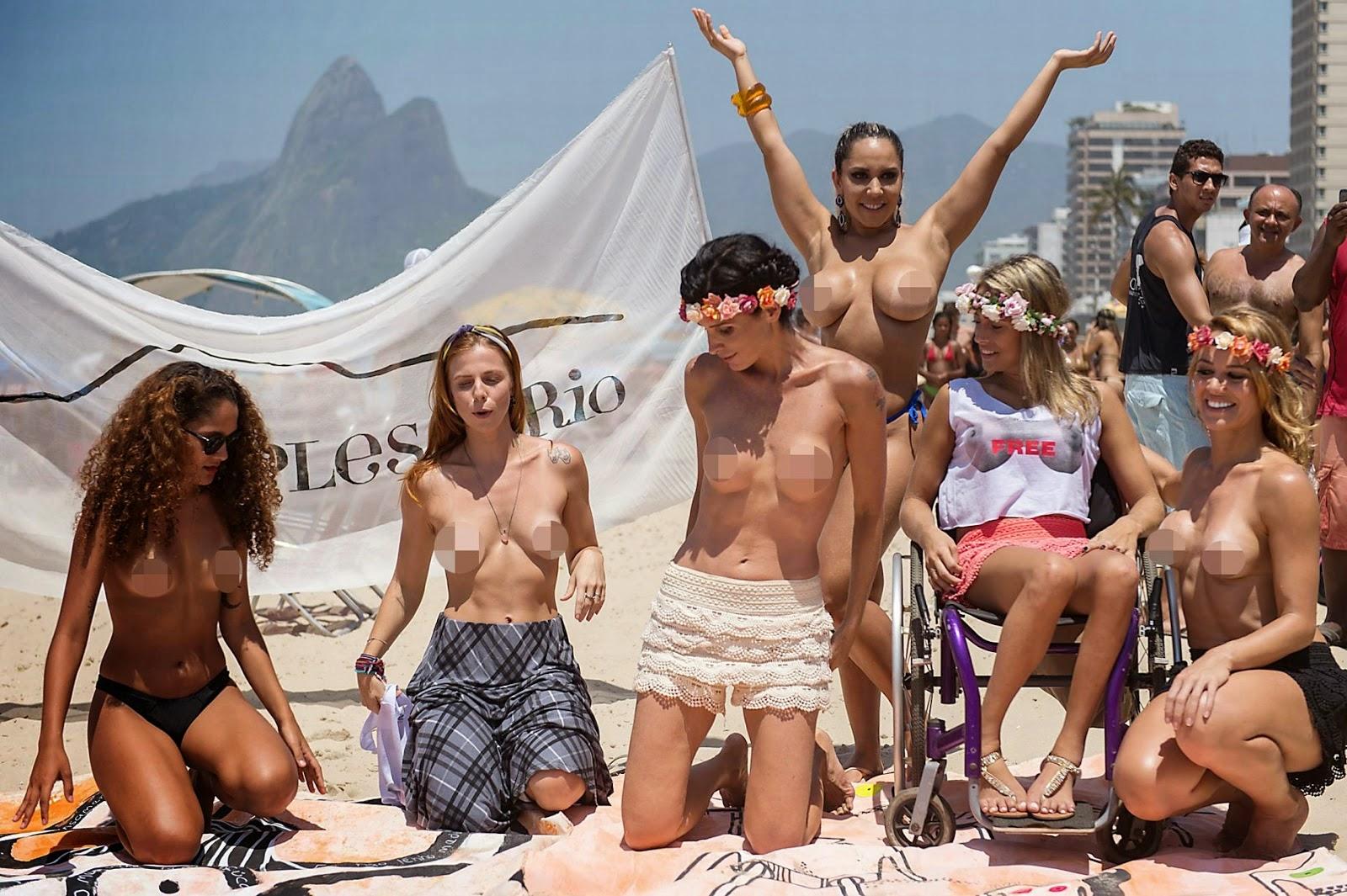 Busty lesbians on the beach