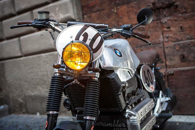 "BMW K100 Street Scrambler Custom BMW K100 Street Scrambler by George de Angelis ""racecafe"" workshop in Rome. BMW K100 Street Scrambler features include a custom leather handmade saddle, The BMW K100 rear sub-frame was custom built. custom Motocross handlebars with custom grips. BMW K100 Custom headlamp grill, Enduro tires makes this BMW K100 Street Scrambler a minimalist beauty."