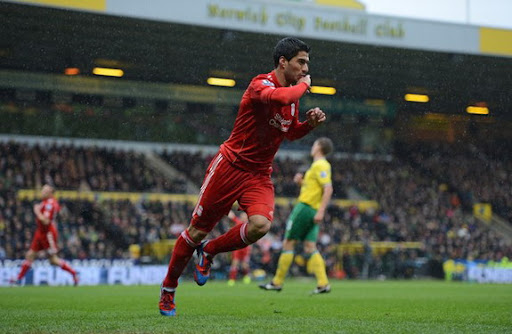 Liverpool striker Luis Suárez celebrates after scoring his first goal against Norwich